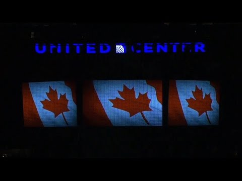The United Center takes a moment of silence and sings �O Canada� to pay their respects after the recent tragedies in Canada.