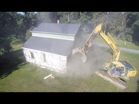 Heavy Equipment Excavator in Action 1840 House Demolition