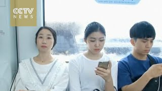 Device helps pregnant women get seats on trains in South Korea