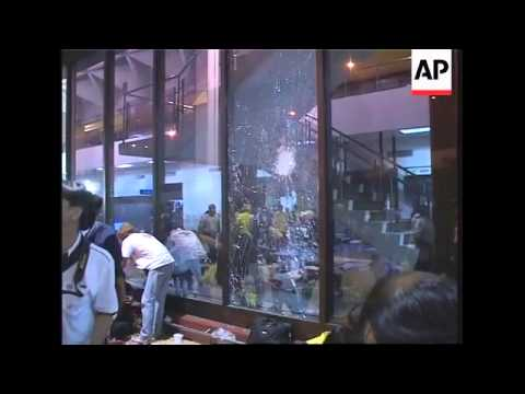 Thailand airport hit by small explosion, 13 protesters injured