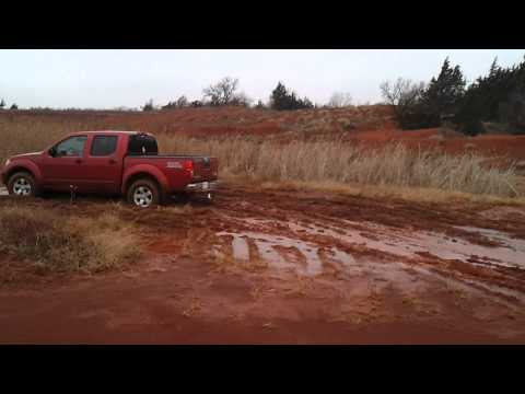 2012 nissan frontier crew cab 4x4 going through mu