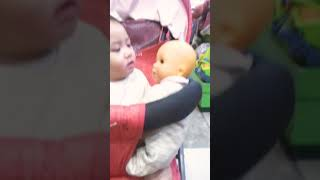 Funny baby scared of doll.....funniest baby video ever