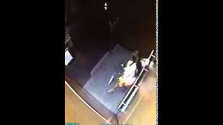 Woman urinates in an elevator