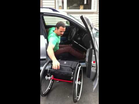 Paraplegic car to wheelchair transfer and wheel chair reassembly