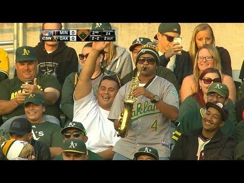 Fan plays saxophone during Reddick's at-bat