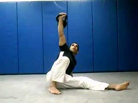 perfectly executed kettlebell full body exercise - turkish get up Image 1