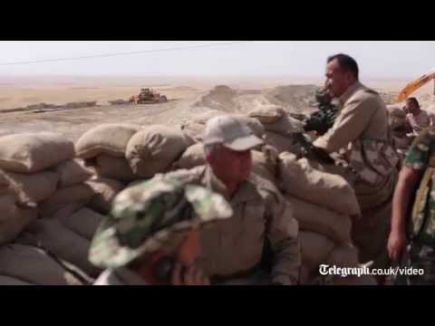 Iraq: Kurdish forces loosen IS grip on Mosul dam