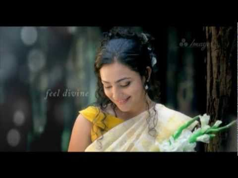 NITHYA MENON IN JOYALUKKAS WEDDING CENTRE AD