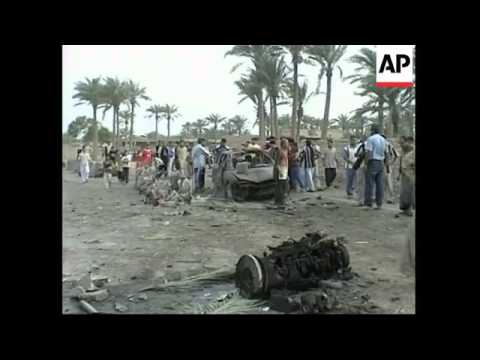Suicide truck bomb explodes at police checkpoint, killing at least 15