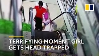 Girl gets head trapped by escalator