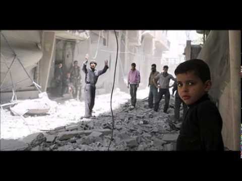 Syrian jets pound insurgent-held town, monitor says