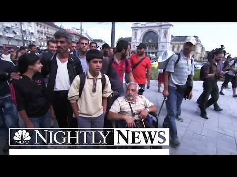 Desperate and Hungry, Thousands of Refugees Leave Budapest for Austria by Foot | NBC Nightly News