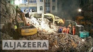 China to probe multiple building collapse
