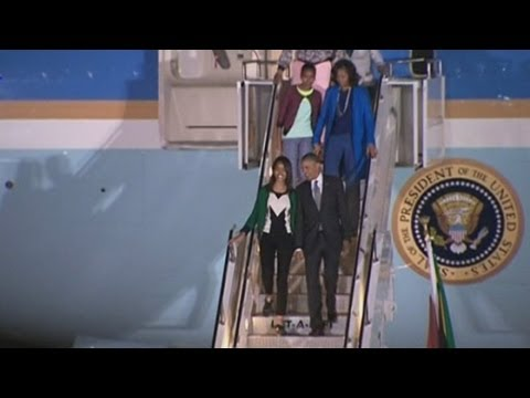 President Obama arrives in South Africa: Obama speaks about Mandela on board Air Force One