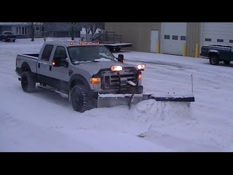 2008 Ford Super Duty Plowing Snow with Snowdogg V Plow