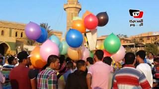 الإخوان تحتفل ببالونات مرسي أول أيام العيد