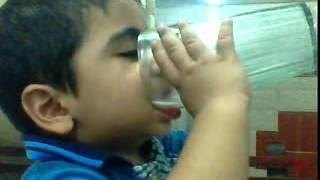 Rayan Babu sb. teaching kids how to take MILK
