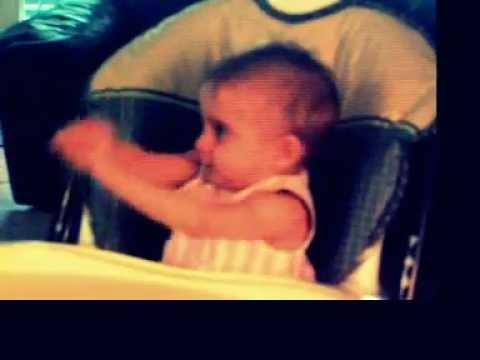 "Angelina waving her hands to ""I want to be a billionare"" 8 months old dancing.MOV"