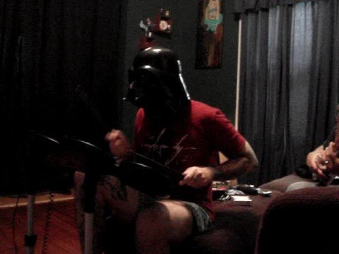 darth vader tattoo. darth vader playing rock band.
