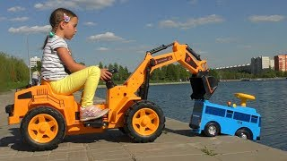 Sofia on toy Excavator Helps the Tayo Little Bus on the Playground for children