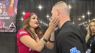 John Cena searches out Nikki Bella for a kiss at Wizard World Philadelphia: June 7, 2016