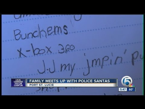 Family meets up with police Santas in Port St. Lucie