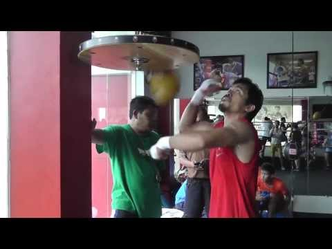 Manny Pacquiao hits speed bag in training for Rios Image 1