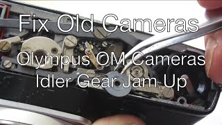 Fix Old Cameras: OM Cameras Idler Gear Jam-Up