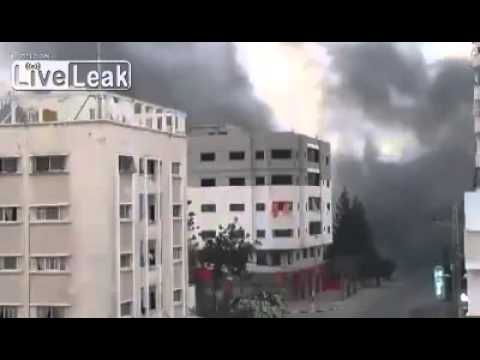 Guy goes nuts as 14 stories building in Gaza is knocked down