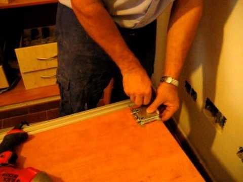 Armario empotrado, (6 /7), colocar puertas correderas, poner tiradores y guías.