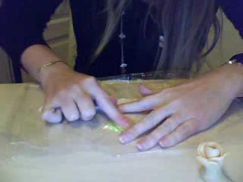 Sugar crafted maroon liles , Maori flax koru heart cake topper and flax
