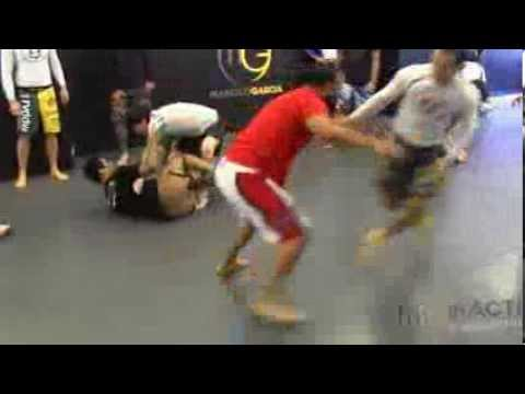 Marcelo Garcia  training takedowns with Johny Hendricks Image 1