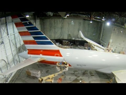 How will the American Airlines merger with US Airways impact consumers?