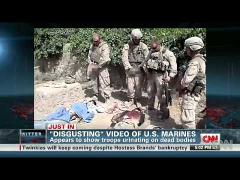 Washington (CNN) -- A number of websites including TMZ and YouTube posted a video Wednesday showing four men dressed in U.S. Marine Corps combat gear urinati...