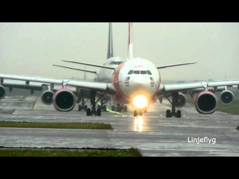 AirAsia X A330-343X depart in the rain