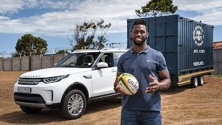 Land Rover Discovery and Siya Kolisi Tow a Rugby Clubhouse