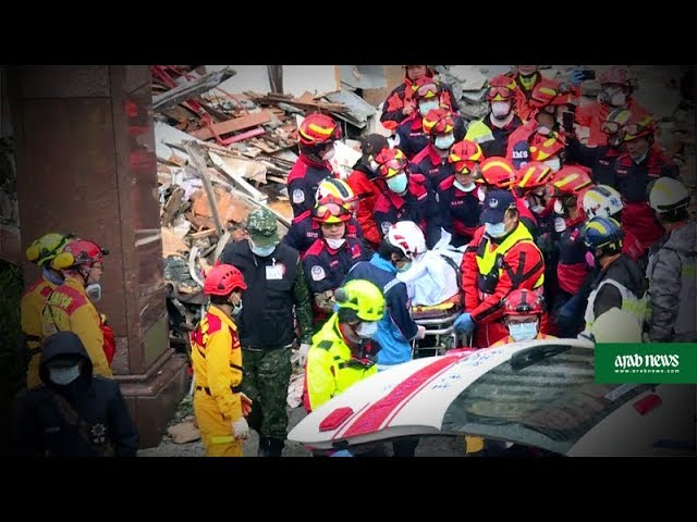 Workers try to shore up tilted buildings after Taiwan quake