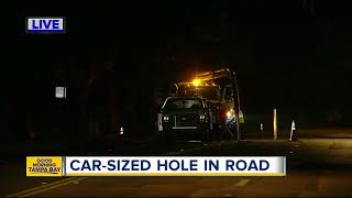 Hillsborough deputies stop traffic at intersection after a hole opens in the roadway
