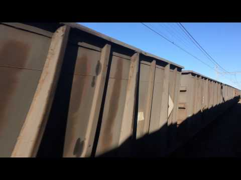 South African Transnet freight train passing Shosholoza Meyl