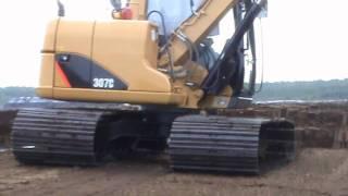 Bagger Caterpillar 307C Baumaschinen im Moor