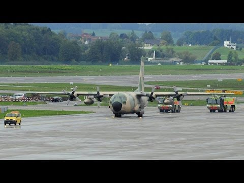 Oman Air Force Hercules taxiing with fire brigade and Qatar Amiri Flight A-310 taxi