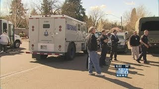 Armed man confronts Brinks truck worker