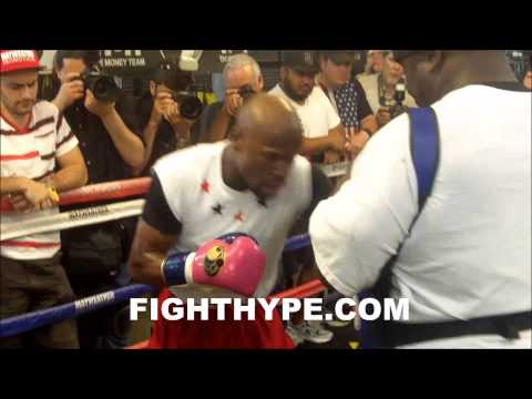 FLOYD MAYWEATHER WORKS THE MITTS WITH UNCLE ROGER AT MEDIA DAY FOR MARCOS MAIDANA FIGHT