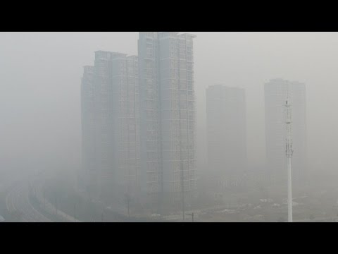 China: Beijing declares first ever red alert for polluted smog
