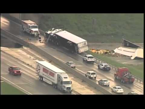 Raw video: Tornado lifts vehicles from I-40