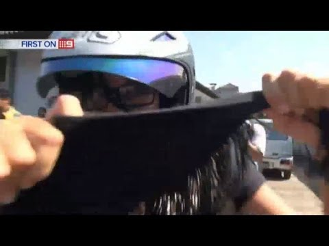 Schapelle Corby punches news camera - Video