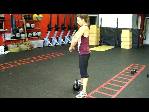Team CrossFit - Kettlebell sumo deadlift high pull Image 1