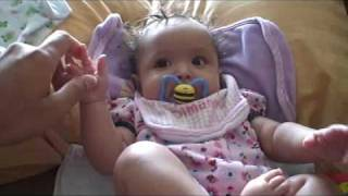 JULY 19TH, 2009 - BABY GIRL PLAYING WITH TOY