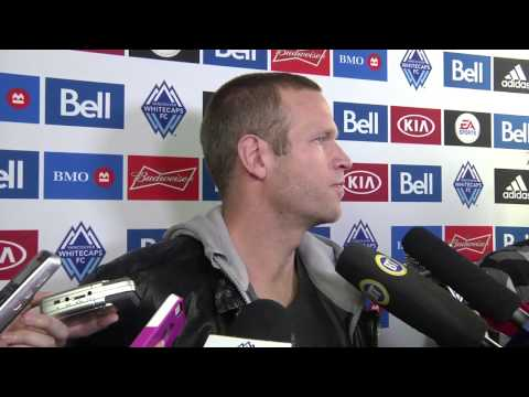 Whitecaps FC captain Jay DeMerit talks to media