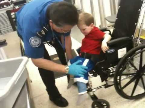 Thumbnail of video TSA Nabs Suspected Al Queda Terrorist At Chicago Airport, A toddler in a wheelchair